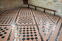 Floor-tile, the Refectory, lying on the same level as the abbey church and the cloister, the Merveille (Marvel), 13th century, thanks to a donation by the king of France, Philip Augustus who offered Abbot Jourdain, a grant for the construction of a new Gothic-style architectural set, Le Mont Saint Michel, Manche, Basse Normandie, France. Picture by Manuel Cohen