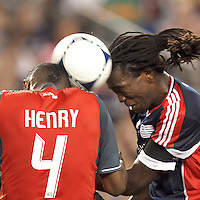 Toronto FC defender Doneil Henry (4) and New England Revolution substitute midfielder Shalrie Joseph (21) head the ball. In a Major League Soccer (MLS) match, Toronto FC defeated New England Revolution, 1-0, at Gillette Stadium on July 14, 2012.