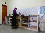 """Sawsan Al Khalili, 40 years-old, a Palestinian woman of special needs prepares tea at her house in Gaza city on Feb. 11, 2017. Al Khalili secretary general of the general union of the Palestinian disabled and a head of the Palestinian farsat club for women with disabilities and she has a degree in law and information technology. """"I defend the rights of the disabled and became their ambassador in six European countries"""" Al Khalili said. Photo by Samar Eliwa"""