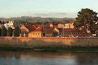 Former Slaughterhouse of Tortosa, Modernist Catalan building built 1906-08 on the banks of the Ebro river with the involvement of architect Paul Monguio, Tortosa, Tarragona, Spain. In the background is the Tortosa wind farm on the mountain tops. Picture by Manuel Cohen