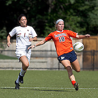 University of Virginia defender Amanda Fancher (18) passes the ball as Boston College forward Victoria DiMartino (1) closes. Boston College defeated University of Virginia, 2-0, at the Newton Soccer Field, on September 18, 2011.