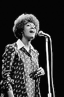 "27 Oct 1972 --- Dionne Warwick giving support during a Women-Only concert to Senator George McGovern of South Dakota, the Democratic candidate for the presidential campaign against Richard Nixon. The ""Musical Spectacular"" at Madison Square Garden also showcased the talents of Tina Turner, Melina Mercouri, Mary Travers, Shirley McLaine, Judy Collins, Bette Davis, with the support of Rose Kennedy. --- Image by © JP Laffont/Sygma/Corbis"