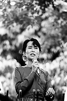 Daw Aung San Suu Kyi, Nobel Peace Prize Laureate and General Secretary of the National League for Democracy (NLD), delivering a speech to supporters at the gates of her home.