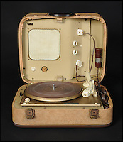 BNPS.co.uk (01202 558833)<br /> Pic: DavidLay/BNPS<br /> <br /> ***Please use full byline***<br /> <br /> Whole lot of shakin going on...<br /> <br /> The record player owned by Elvis Presley during his time in the US Army in Germany is being auctioned in Devon.<br /> <br /> And it has emerged that the vintage turntable led to the King of Rock'n'Roll being evicted from the Grunewald hotel in Bad Nauheim after a string of loud parties in 1959. <br /> <br /> Elvis was asked to leave the hotel in February of that year after leaving other guests all shook up by his frequent parties. <br /> <br /> One guest, Ellen Jenkins, told Elvis that she was about to marry an Englishman and move to Britain so he gave her the Perpetuum Ebner Musical 5v Luxus player as an early wedding present.