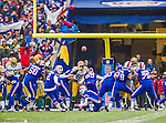 14 December 2014: Buffalo Bills kicker Dan Carpenter converts a touchdown in the first quarter against the Green Bay Packers at Ralph Wilson Stadium in Orchard Park, NY. The Bills defeated the Packers 21-13, snapping the Packers' 5-game winning streak and keeping the Bills' 2014 playoff hopes alive. Mandatory Credit: Ed Wolfstein Photo *** RAW (NEF) Image File Available ***