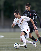 Boston College midfielder/defender Colin Murphy (21) on the attack. Brown University (black) defeated Boston College (white), 1-0, at Newton Campus Field, October 16, 2012.