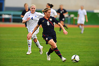 USA's Amy Rodriguez attacks, as Iceland's #4 Rakel Honnudottir gives chase.  The USWNT defeated Iceland (2-0) at Vila Real Sto. Antonio in their opener of the 2010 Algarve Cup on February 24, 2010.