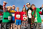 Conor McCarthy (in front), Trish Horan, Vincent Horan, Sean Horan, Claire McCarthy, Gary Horan and Eileen Scanlon, pictured at the Santa Fun Run, in aid of Barretstown, starting from the Tralee Bay Wetlands, on Sunday last.