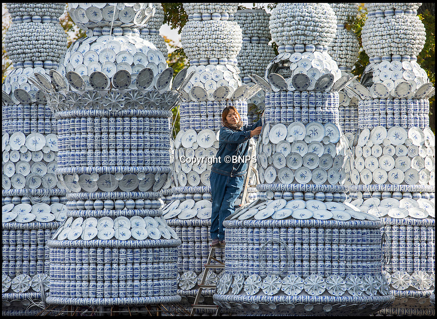 BNPS.co.uk (01202 558833)<br /> Pic: PhilYeomans/BNPS<br /> <br /> Thats a lot of china...<br /> <br /> Europes largest Festival of light is under construction at Longleat House in Wiltshire.<br /> <br /> Centrepeice of the display will be will be a twenty-metre-tall Porcelain Pagoda &ndash; created out of 80,000 porcelain cups, bowls and plates<br /> <br /> A army of workers specially brought in from Zigong in China&rsquo;s Sichuan province are creating the winter spectacular for the Wiltshire attraction.<br /> <br /> The stunning show also involves 12 miles of silk, 14 miles of LED lighting and 76 tonnes of steel wire to make the various figures.