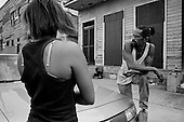 New Orleans, Louisiana.USA.July 29, 2006..Darryl McDaniel, the father of two victims of a quadruple homicide that happened the night before at this place, stands and talks to neighbors on the street where his sons were shot and killed...A quadruple homicide in the city center happened the night before. Crime is on the rise as residents return looking for work and living in questionable housing conditions. Younger drug lords try to claim territory in the destroyed New Orleans districts nearly one year after hurricane Katrina hit and the levees broke leaving 80% of the city flooded. .