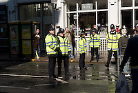 Metropolitan Police constables stand on duty at an Anonymous protest against the Church of Scientology on April 12, 2008 across from the Dianetics & Scientology Life Improvement Centre on Tottenham Court Road, Camden, London, UK.