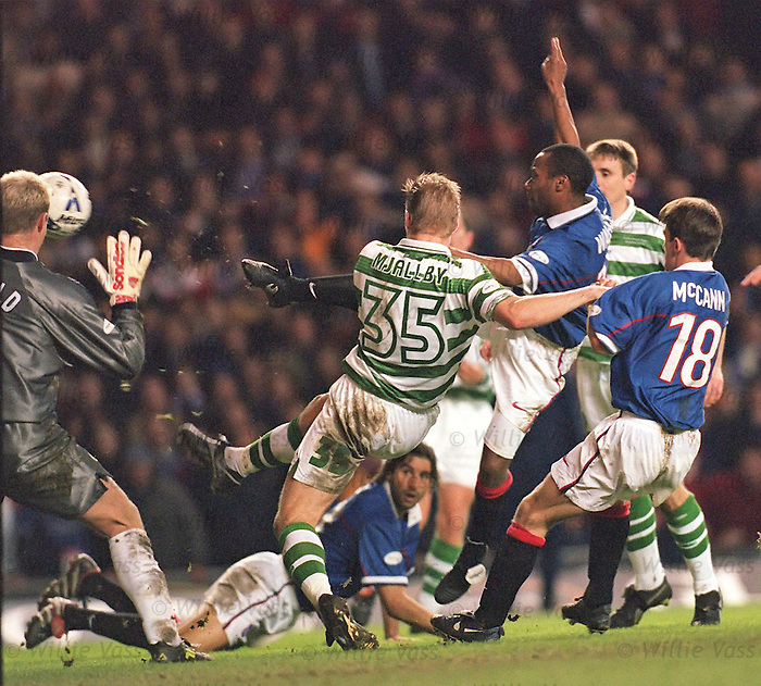 Rod Wallace scores past Jonathan Gould in goals for Celtic at Ibrox old firm encounter
