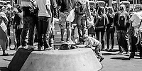 Child climbing concrete mound. Lower Queen Street, Auckland.