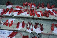 Roma  25 Novembre 2013<br /> Manifestazone in Campidoglio nella  Giornata internazionale contro la violenza sulle donne a Roma. Le scarpe rosse in memoria  delle donne  uccise  che quelle scarpe, non indosseranno mai pi&ugrave;.<br /> Rome, Italy. 25th November 2013 -- The capitol in Rome glows red with a call to end violence against women is projected on the building. -- The capitol in Rome is lit red in observance of the International Day to stop violence against women.The red shoes in memory of the women killed those shoes, do not wear anymore.