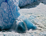 A large section of Glacier Perito Moreno calves into the waters of Lago Argentino of the Southern portion of Parque Nacional Los Glaciares of Argentina.
