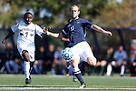 21 October 2012: Penn State's Brian Forgue (13) clears the ball away from Northwestern's Lepe Seetane (LES) (7). The Northwestern University Wildcats played the Penn State University Nittany Lions at Lakeside Field in Evanston, Illinois in a 2012 NCAA Division I Men's Soccer game. Penn State won the game 1-0 in golden goal overtime.