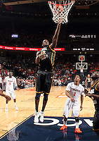 CHARLOTTESVILLE, VA- DECEMBER 6: Mike Morrison #22 of the George Mason Patriots shoots over Jontel Evans #1 of the Virginia Cavaliers during the game on December 6, 2011 at the John Paul Jones Arena in Charlottesville, Virginia. Virginia defeated George Mason 68-48. (Photo by Andrew Shurtleff/Getty Images) *** Local Caption *** Mike Morrison;Jontel Evans