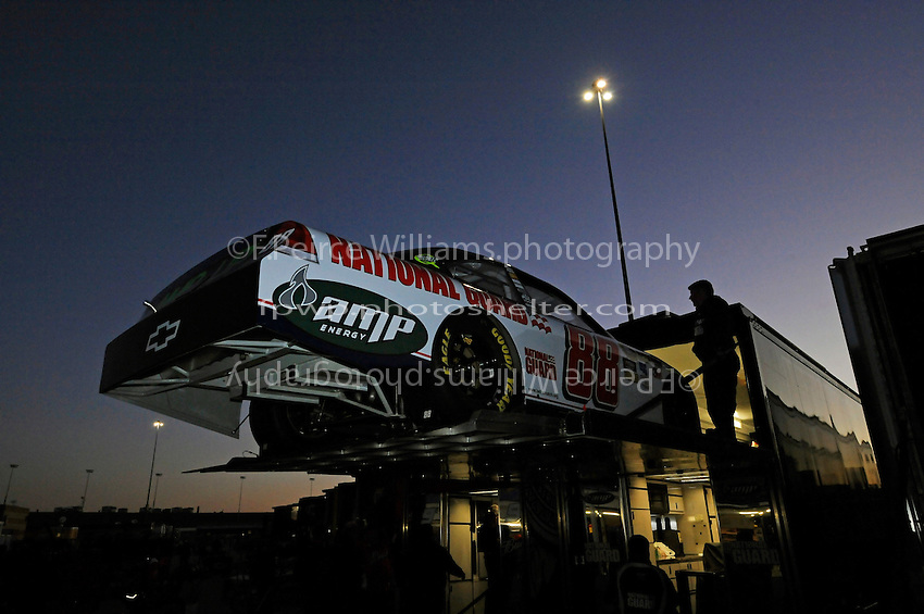 the car of Dale Earnhardt,Jr. (#88) is unloaded at daybreak.