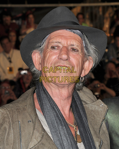 """KEITH RICHARDS .Premiere of """"Pirates of the Caribbean : On Stranger Tides"""" held at Disneyland in Anaheim, California, USA..May 7th 2011.4 four headshot portrait  grey gray hat scarf earring hoop  .CAP/RKE/DVS.©DVS/RockinExposures/Capital Pictures."""