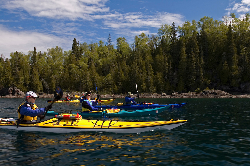 A group of sea kayakers paddle through Tugboat Channel in Lake Superior Provincial Park near Wawa Ontario Canada.
