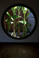 this temple: <br /> a garden full <br /> of banana plants. <br /> - Basho<br /> <br /> A round window at the Kenninji Temple in Kyoto displays a planting of banana trees.<br /> <br /> (title translation David Landis Barnhill)