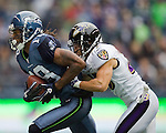Seattle Seahawks wide receiver Sidney Rice is pushed out of bounds by Baltimore Ravens safety Tom Zbiowski at  CenturyLink Field in Seattle, Washington on November 13, 2011. The Seahawks beat the Ravens 22-17. ©2011 Jim Bryant Photo. All Rights Reserved.