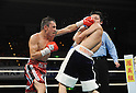 (L-R) Hugo Cazares (MEX), Hiroyuki Hisataka (JPN), DECEMBER 23, 2010 - Boxing : Hugo Fidel Cazares of Mexico in action against Hiroyuki Hisataka of Japan during the 7th round of the WBA super flyweight title bout at Osaka Prefectural Gymnasium in Osaka, Osaka, Japan. (Photo by Mikio Nakai/AFLO).