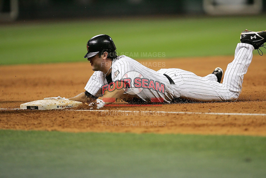 Houston Astros 1B Lance Berkman slides into third after hitting a triple on Friday May 23rd at Minute Maid Park in Houston, Texas. Photo by Andrew Woolley / Four Seam Images..