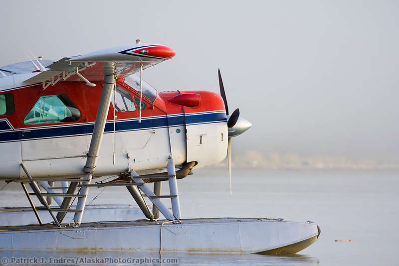 Float plane on Naknek lake in the morning fog, Katmai National Park, Alaska.