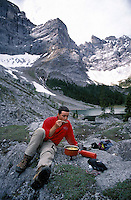 CANADA, ALBERTA, KANANASKIS, MAY 2002. A hiker cooks lunch at the Upper Tombstone lake The beautiful  Tombstone lakes are surrounded by mountains. The Kananaskis Country provincial park is home to Canada's most beautiful nature and wildlife. It has also escaped the mass tourism as in Banff National Park. Photo by Frits Meyst/Adventure4ever.com