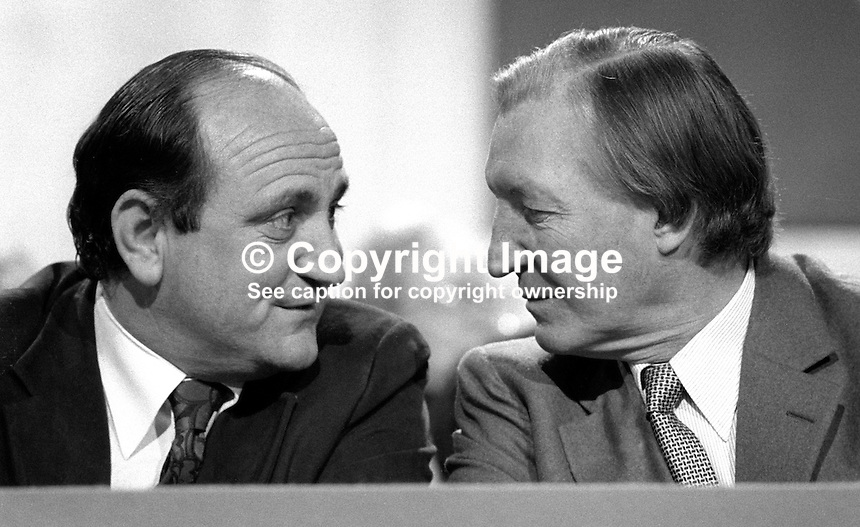 Charles Haughey, TD, Prime Minister, Taoiseach, Rep of Ireland, right, chatting with his Minister for Justice, Gerry Collins, on the platform at the Fianna Fail Ard Fheis, February 1981. 198102000030CH+GC..Copyright Image from Victor Patterson, 54 Dorchester Park, Belfast, United Kingdom, UK...For my Terms and Conditions of Use go to http://www.victorpatterson.com/Victor_Patterson/Terms_%26_Conditions.html