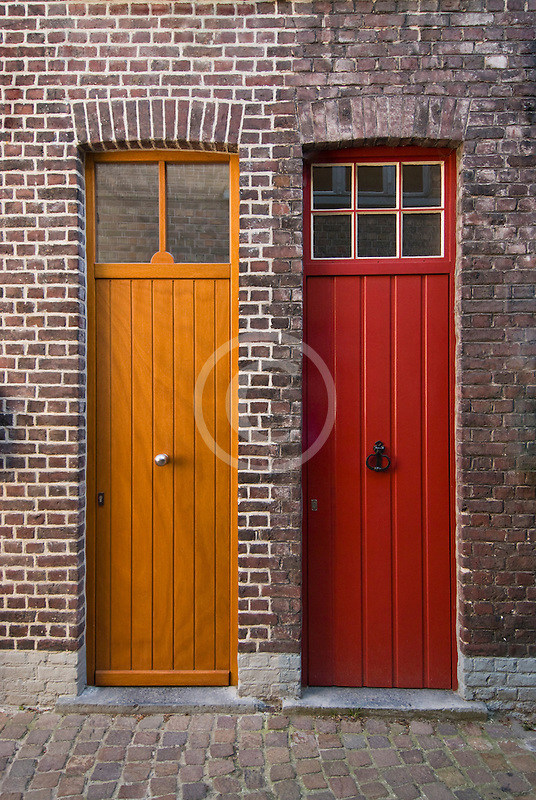 Belgium, Bruges, Painted doors and brick wall