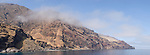 Guadalupe Island, Baja California, Mexico; a panoramic view of the rocky cliffs on the leeward side of the northern part of the island, near the northeast anchorage, in afternoon sunlight
