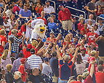 20 September 2013: Washington Nationals Mascot Screech delivers a pizza to a lucky fan during a game against the Miami Marlins at Nationals Park in Washington, DC. The Nationals defeated the Marlins 8-0 to take the second game of their 4-game series. Mandatory Credit: Ed Wolfstein Photo *** RAW (NEF) Image File Available ***