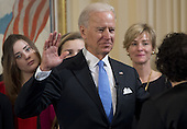 United States Vice President Joe Biden takes the oath of office during the 57th Presidential Inauguration official swearing-in ceremony at the Naval Observatory on January 20, 2013 in Washington, DC. The oath is administered by US Supreme Court Justice Sonia Sotomayor.  .Credit: Saul Loeb / Pool via CNP
