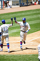 4 May 2011: Carlos Pena crosses home plate after scoring a run in the sixth inning.  The Cubs defeated the Dodgers 5-1 during a Major League Baseball game at Dodger Stadium in Los Angeles, California.  Dodgers players are wearing Brooklyn Dodger 1940's throwback jersey uniforms and the Cubs are also wearing throwback retro jersey uniforms. **Editorial Use Only**