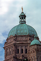 Victoria: Parliament Bldgs.--detail. Gilded Capt. George Vancouver atop colored dome.  Photo '88.