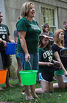 """Account specialist Kathie Hanning of Ohio Universities Financial Aid Department gives her speech for the watching audience as to why the department is participating in the """"Ice Bucket Challenge."""" Almost the entire department was soaked in honor of Vicky Boyles, a coworker who was forced to leave her work as the Assistant Director of Financial Aid at the end of last March due to her battle against PMA. The group gathered behind Chubb Hall on College Green on Wednesday, August 27, 2014. Photo by Katelyn Vancouver"""