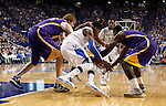 LSU and UK scramble for the ball during the first half of the men's basketball game vs. LSU at Rupp Arena, in Lexington, Ky., on Saturday, January 26, 2013. Photo by Genevieve Adams  | Staff.
