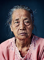 "Mardiyah (born 1926) was one of tens of thousands of 'comfort women' forced into prostitution by the Japanese military during World War II..A Japanese corporal took the married Mardiyah under the pretext of getting a job as a laundry lady and forced her into sexual services as a live-in at a nearby barracks. She also had to wash clothes and help forced labourers build roads and dig trenches. After his reassignment, the corporal took her with him, first to barracks in Ambarawa and later back to Banyubiru. Mardiyah miscarried while hauling rocks. ""I didn't even know I was pregnant, but when I saw the bleeding, I was relieved. At least I was spared the shame of having a Japanese child. Nothing would stand in the way of me meeting my husband again, I thought then."" At the end of the war, she managed to escape during a transport of a large group of prisoners. But she would never see her husband again. He had ended up in Kalimantan as a forced labourer and had remarried there. ""I received a letter from him in which he wrote: 'You can just go to Japan, if you like.' But why would I want to go there?"" She stayed in the village and married two more times. With her third husband, she had three children. ""They come to visit me sometimes. I live here by myself now and work in the fields.""."