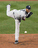 New York Yankees pitcher Ivan Nova (47) works in the second inning against the Baltimore Orioles at Oriole Park at Camden Yards in Baltimore, MD on Monday, April 9, 2012..Credit: Ron Sachs / CNP.(RESTRICTION: NO New York or New Jersey Newspapers or newspapers within a 75 mile radius of New York City)