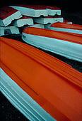 Row boats stored on a beach.