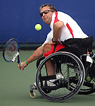 Yann Mathieu of Trois Rivieres, Que. in wheelchair tennis action at the Paralympic Games in Beijing, Monday, Sept., 8, 2008.   Photo by Mike Ridewood/CPC