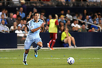 Davy Arnaud (blue) Sporting KC...Sporting KC were held to a scoreless tie with Chicago Fire in the inauguarl game at LIVESTRONG Sporting Park, Kansas City, Kansas.