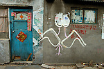 Explicit graffiti on exterior of old hutong housing, soon to be destroyed for new city centre development...From China [sur]real © Mark Henley....