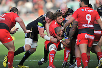Duane Vermeulen of Toulon is tackled by the Bath Rugby defence. European Rugby Champions Cup match, between RC Toulon and Bath Rugby on January 10, 2016 at the Stade Mayol in Toulon, France. Photo by: Patrick Khachfe / Onside Images
