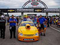 Aug 30, 2014; Clermont, IN, USA; NHRA pro stock driver Kenny Delco with crew members during qualifying for the US Nationals at Lucas Oil Raceway. Mandatory Credit: Mark J. Rebilas-USA TODAY Sports