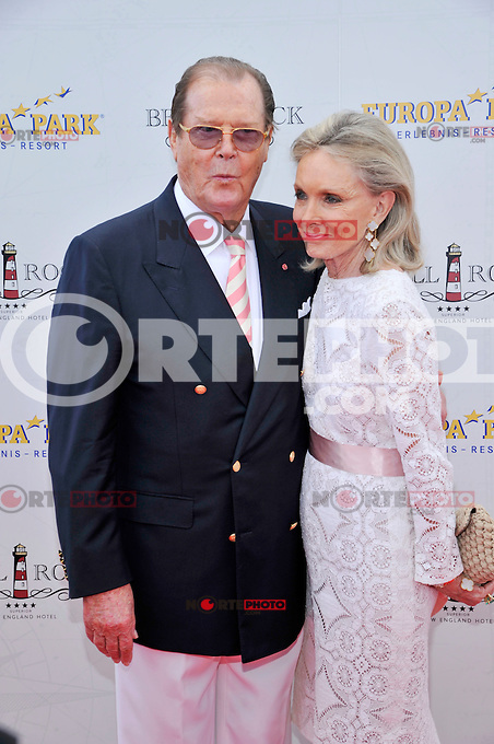 Roger Moore and wife Kristina Tholstrup attending the opening of Hotel Bell Rock at Europapark in Rust, Germany, 12.07.2012...Credit: Tim Morris/face to face /MediaPunch Inc. ***FOR USA ONLY*** ***Online Only for USA Weekly Print Magazines*** /*NORTEPHOTO*<br /> **SOLO*VENTA*EN*MEXICO**<br /> **CREDITO*OBLIGATORIO** <br /> **No*Venta*A*Terceros**<br /> **No*Sale*So*third**<br /> *** No*Se*Permite Hacer Archivo**<br /> **No*Sale*So*third**