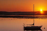 California, Morro Bay, Sailboat at sunset<br /> <br />     Getty Images id 82970891