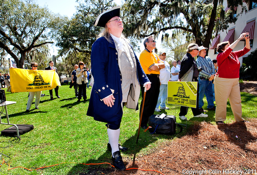 TALLAHASSEE, FLA. 3/8/11-OPENINGDAY030811 CH-Lloyd Wheeler, portraying Ben Franklin, center, takes in the Tea Party rally during the opening day of the 2011 legislative session Tuesday at the Capitol in Tallahassee..COLIN HACKLEY PHOTO